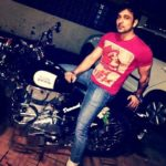 Mehul Bhojak poses with his Royal Enfield bike