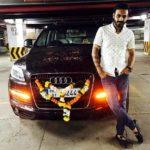 Naitik Nagda poses with his Audi Q7 car