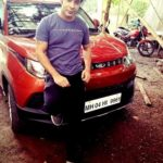 Rahulram Manchanda poses with his Mahindra KUV 100 car