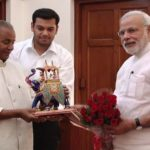 Sandeep Singh along with his grandfather Kalyan Singh and PM Narendra Modi