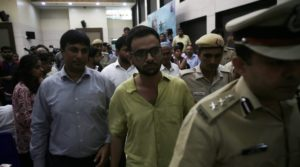 Umar Khalid accompanied by the police after the incident