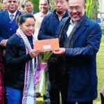 Mirabai Chanu receiving check from N. Biren Singh