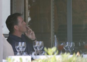 Pierce Brosnan smoking