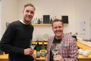 Stuart Broad (left) having alcohol