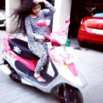 Farhina Parvez poses with her TVS Scooty Pep Plus