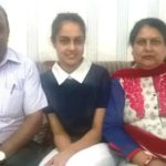 Malvi Malhotra with her parents