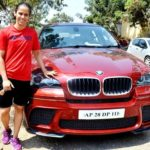 Saina Nehwal poses with her BMW car