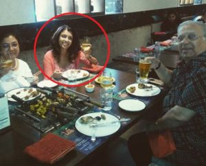 Tina Desai drinking with her parents