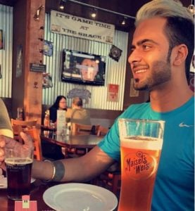 Mankirt Aulakh drinking beer