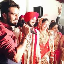 Mankirt Aulakh singing at public marriage functions