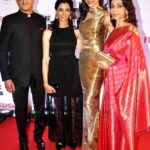 Ujjala Padukone with her husband and daughters