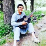 Hazratullah Zazai Playing The Guitar