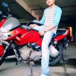 Lavin Gothi poses with his TVS Apache RTR bike