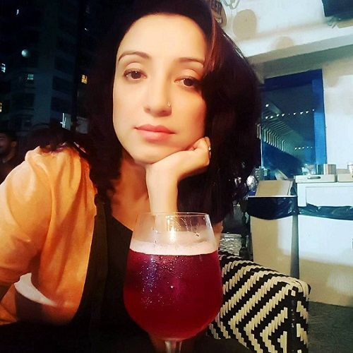Madhurima Nigam with a glass of wine