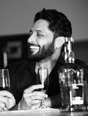 Navdeep Kaler with a glass of wine