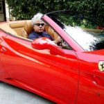 Suhel Seth poses with his Ferrari California car