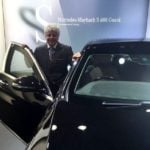 Suhel Seth poses with his Mercedes-Benz S600 car