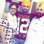 Jordan Sandhu with his parents