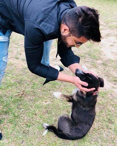 Raman Kapoor loving a dog