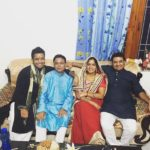 Roman Saini (extreme left) With His Parents & Brother Avesh Saini (extreme right)