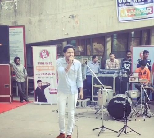 Tyson Sidhu singing during his college fest