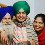 Amar Sehmbi with his parents