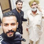 Garry Sandhu with his father and brother