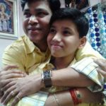 Digamber Naik with his son