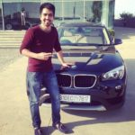 Harrdy Sandhu with his car