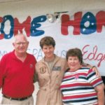 Amy McGrath with her parents