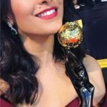 Anita Hassanandani posing with an award