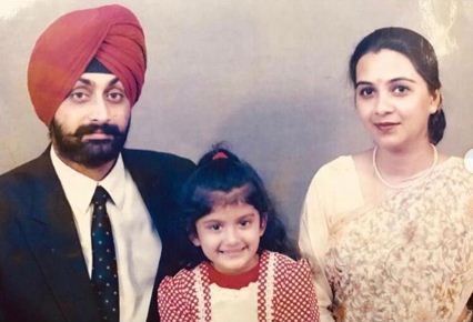 Childhood image of Nimrit Kaur Ahluwalia with her parents