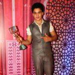 Faisal Khan with an award