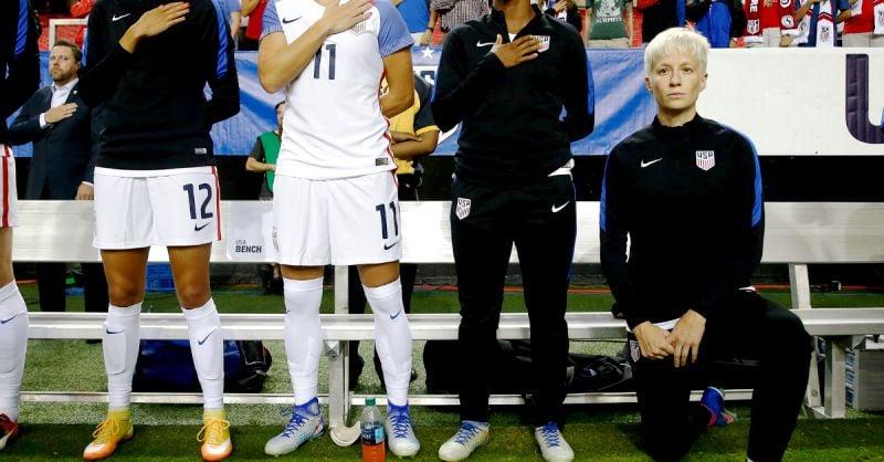 Megan Rapinoe kneeling during the National Anthem