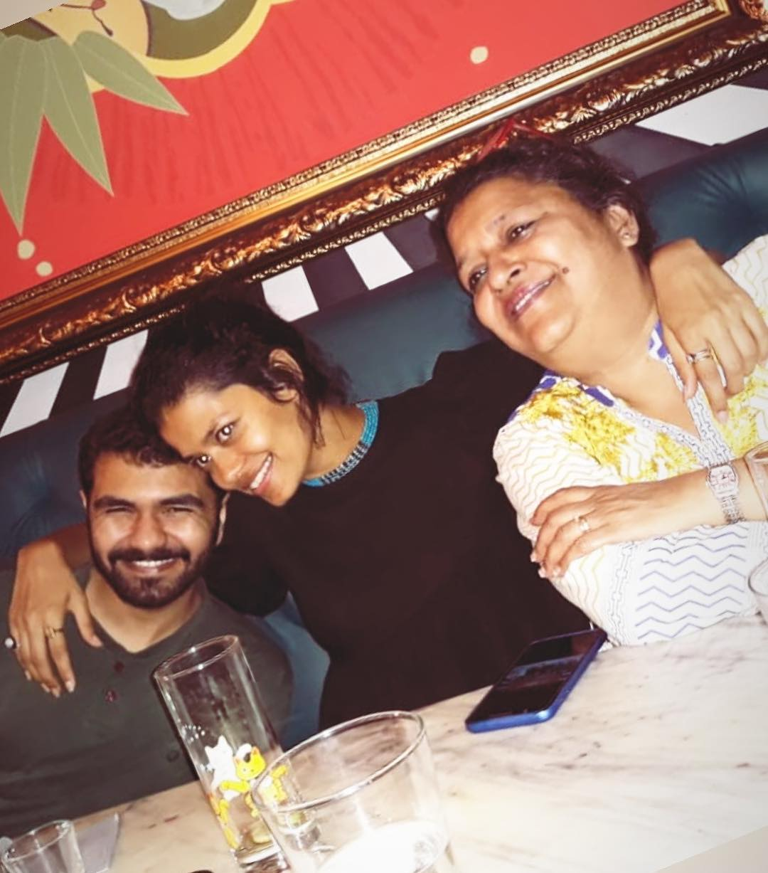 Palomi Ghosh with her brother and mother