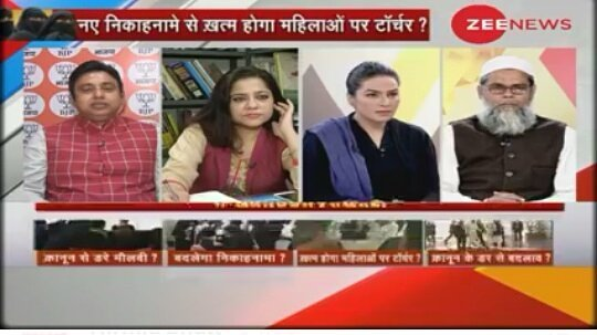 Amber Zaidi taking part in a debate on Zee News