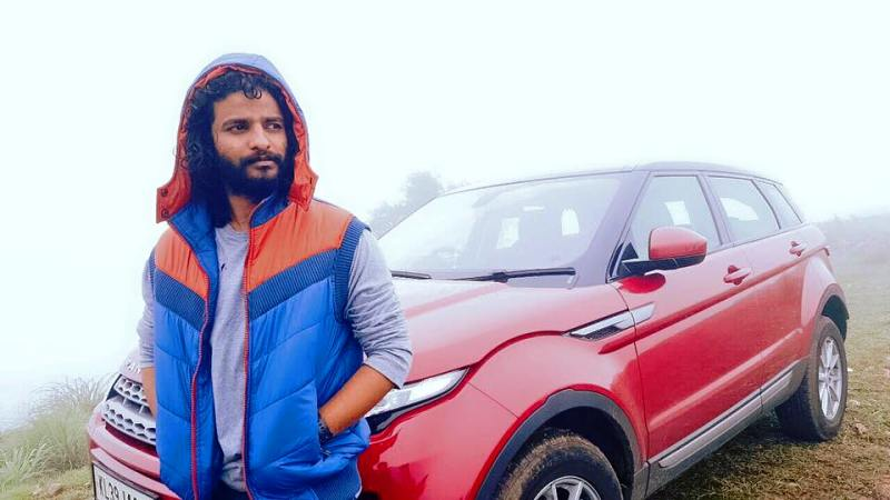 Neeraj Madhav Posing with His Car