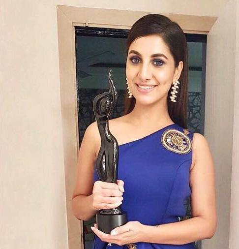 Rukmini Maitra posing with an award