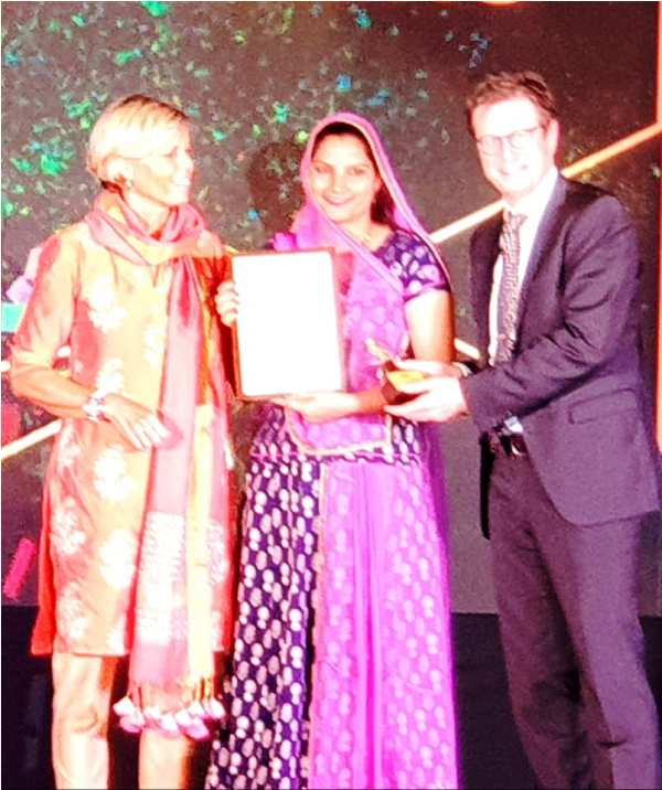 Ruma Devi Receiving an Award