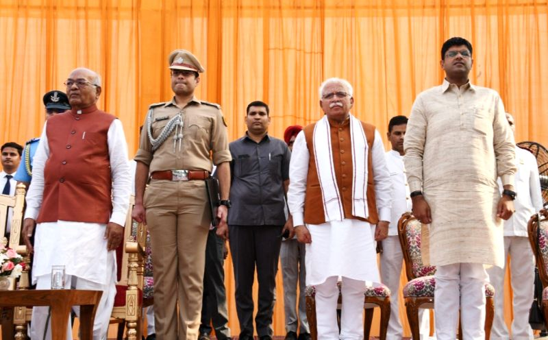 Dushyant Chautala (extreme right) with Manohar Lal Khattar at the oath taking ceremony