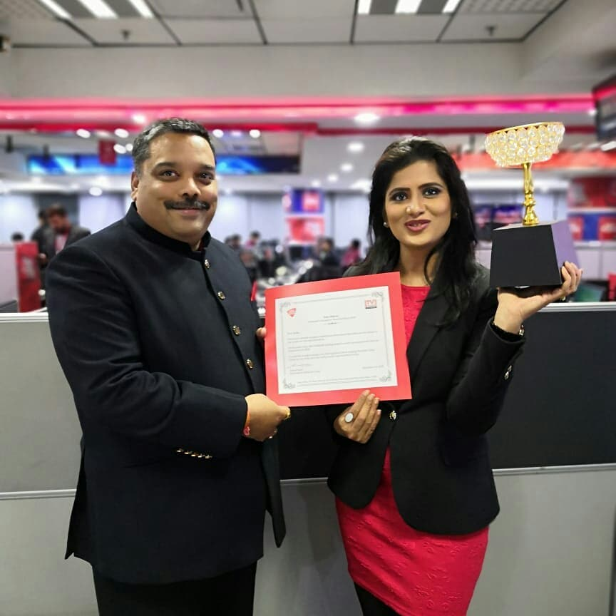 Neha Batham receiving an award