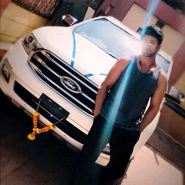 Nishant Malkani Posing with His Car