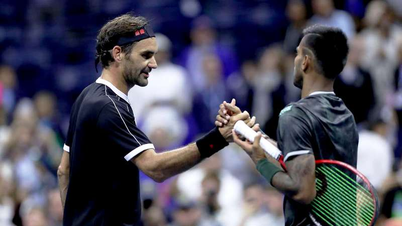 Sumit Nagal with Roger Federer after their match