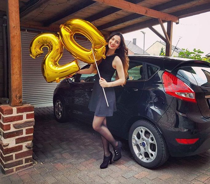 Elif Khan with her car