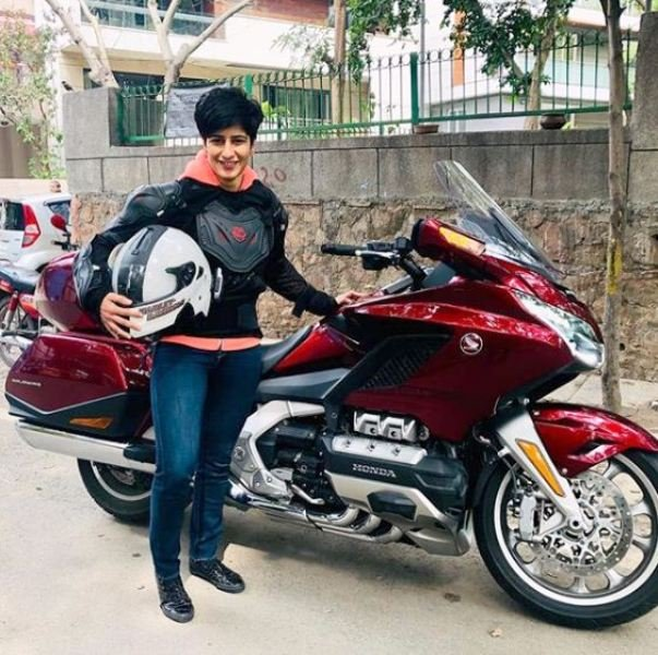 Neeti Palta Posing with Her Motorcycle