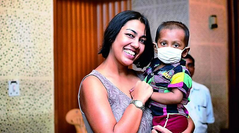 Purnota Dutta Bahl with a Child of Cuddles Foundation
