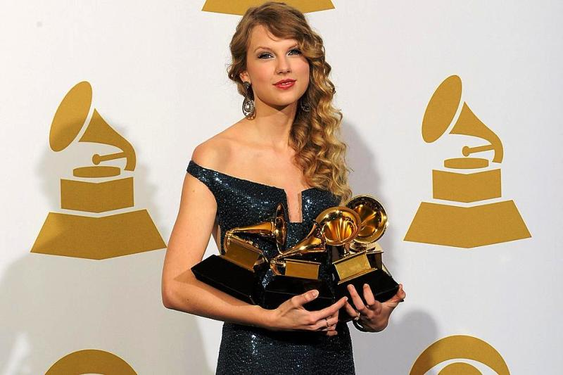 Taylor Swift Posing with Her Grammy Awards