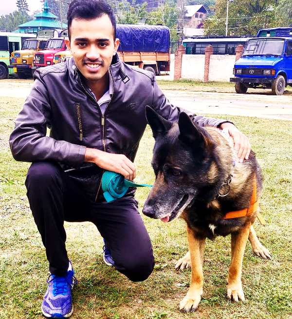 Safin Hasan with a dog from the K-9 unit