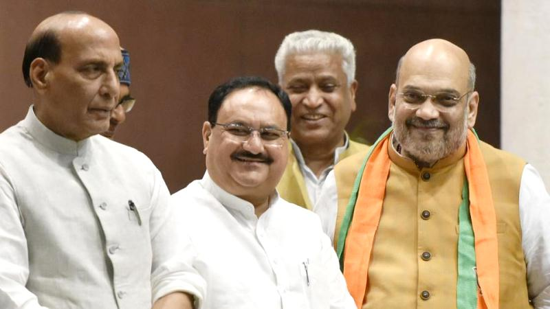 JP Nadda with Amit Shah (right) and Rajnath Singh (left) at the BJP central headquarters