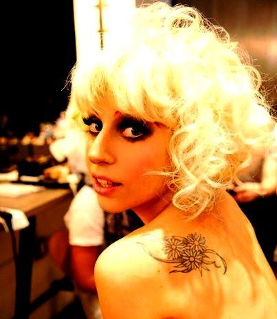 Lady Gaga's daisies tattoo on her left shoulder back